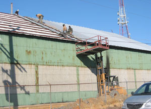 METAL BUILDING RE-ROOFING WAREHOUSE